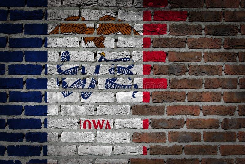 Dark brick wall - Iowa. Dark brick wall texture - flag painted on wall - Iowa royalty free stock photos