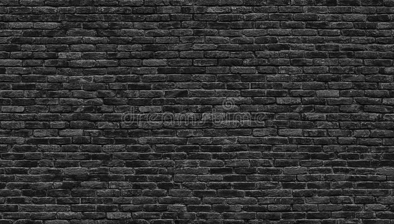 Dark brick wall, texture of a black brick background royalty free stock photo