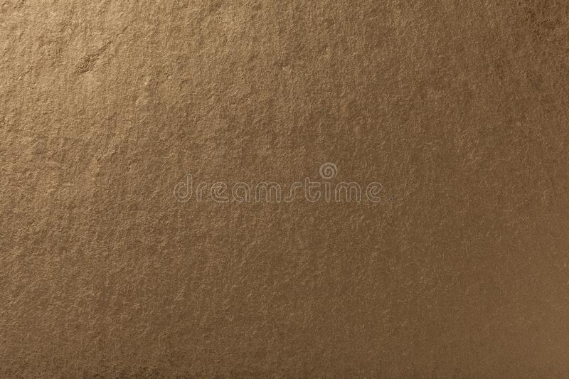 Dark bronze background of natural slate. Texture of brown stone. Closeup. Graphite backdrop macro royalty free stock images