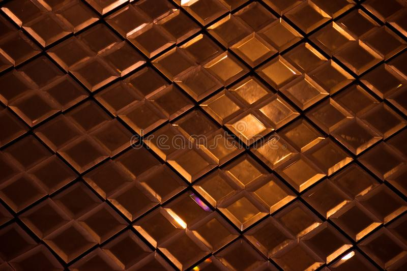 Dark Bronze Reflective glass rhombus diamond abstract texture and background stock image