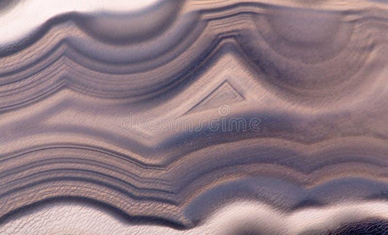 Dark brown agate structure macro. Background with dark brown agate structure royalty free stock images