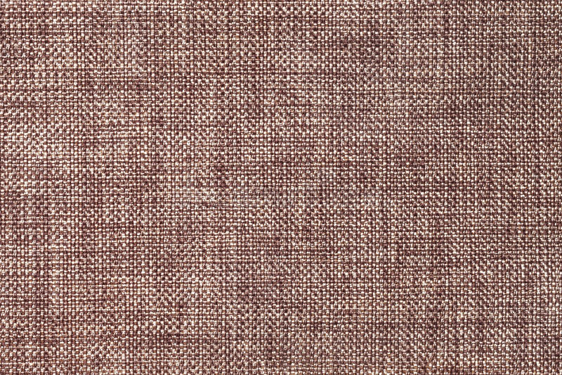 Dark brown background of dense woven bagging fabric, closeup. Structure of the textile macro. Dark brown and white background of dense woven bagging fabric royalty free stock image