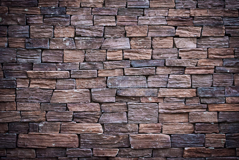 It is Dark brown brick wall for pattern. stock images