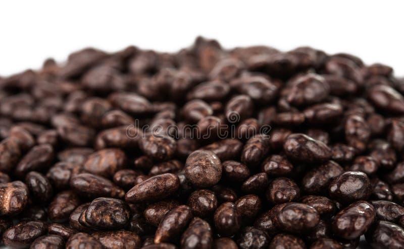 Dark brown dragee, chocolate covered sunflower seeds stock photo