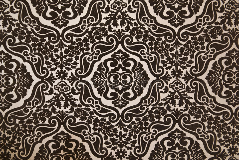 Dark brown flock wallpaper pattern. Detail of a dark brown flock wallpaper pattern stock photography