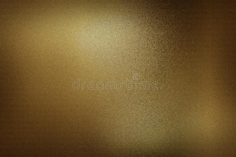 Dark brown foil metallic wall in dark room, abstract texture background royalty free stock image