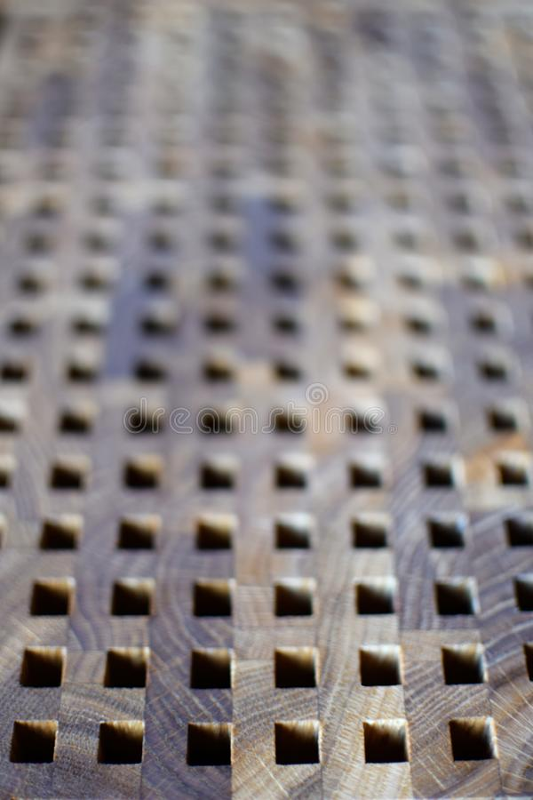 Dark brown grey wood texture board with black squares as vertical blur background. Selective focus royalty free stock photos