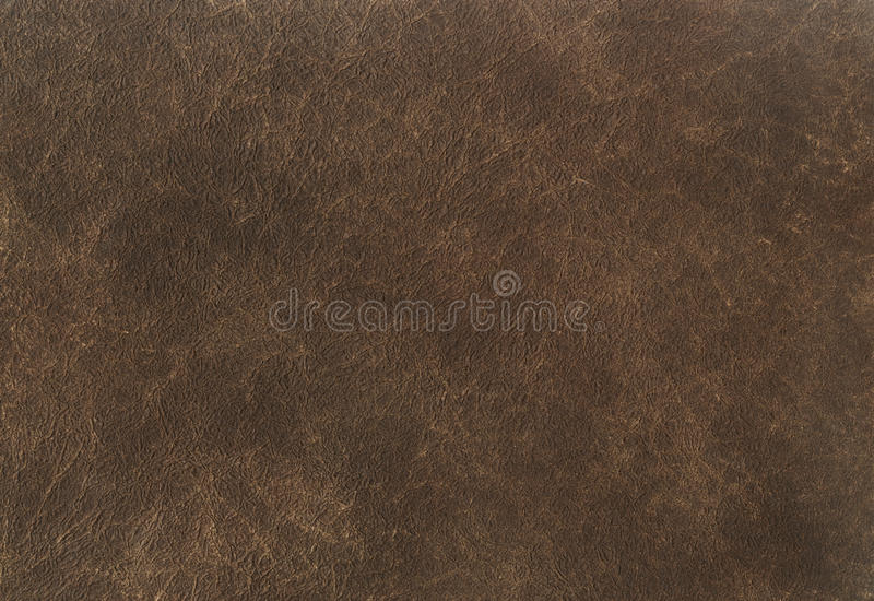 Dark brown leather texture background. Close up of an ancient leather texture. leather texture brown background pattern. royalty free stock images