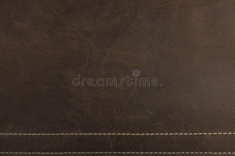 The dark brown Nubuck leather background and texture. Dark brown Nubuck leather background and texture with gold sewing stitch stock illustration