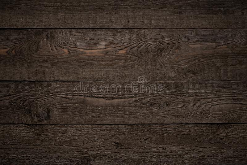 Dark brown old wood striped texture or background.  royalty free stock images