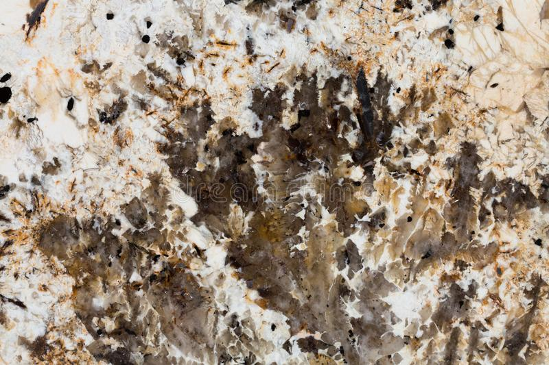 Dark brown, orange, red, white natural stone texture, background. High resolution photo. Dark brown, orange, red, white natural stone texture background stock photography