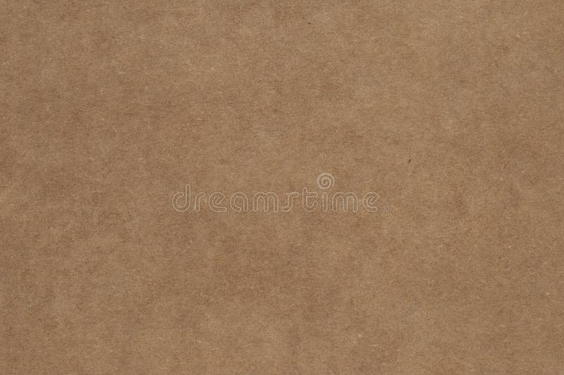 Dark brown paper box surface. Packaging, parchment texture, recycling, package background. Carton container. royalty free stock photo