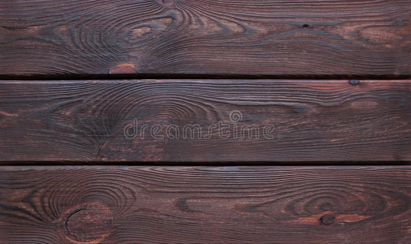 Dark brown scratched wooden cutting board. royalty free stock images