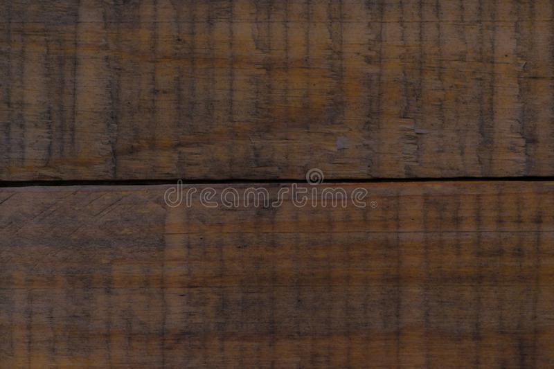 Dark brown scratched wooden cutting board. Wood texture royalty free stock image