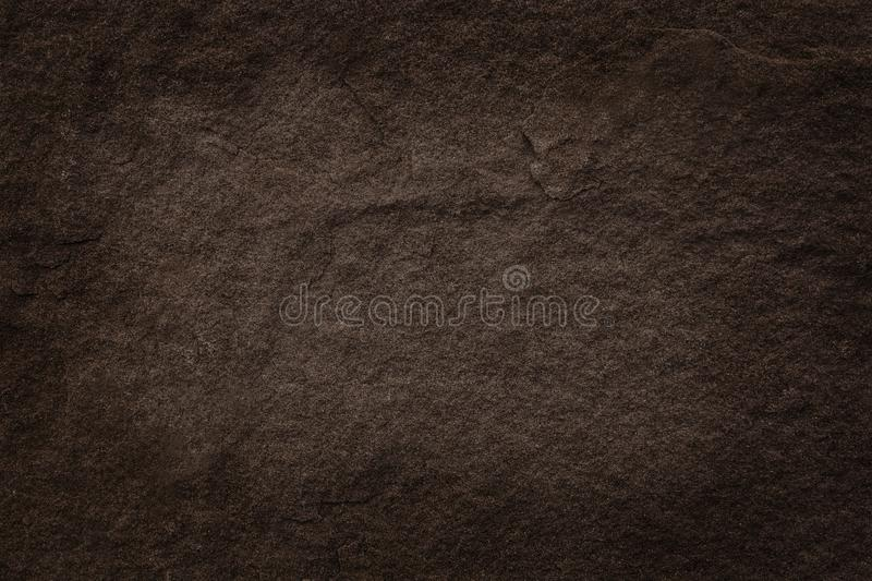 Dark brown slate rock texture with high resolution, background of natural stone wall.  royalty free stock images