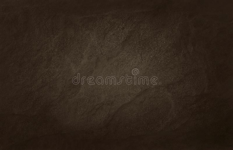 Dark brown slate texture in natural pattern with high resolution for background and design art work. Brown stone wall.  stock photography