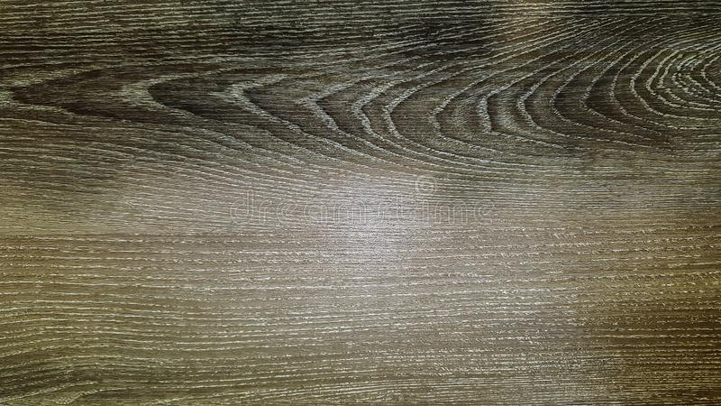 Dark brown wood texture background, beautifully patterned surface, top view of wooden table royalty free stock image