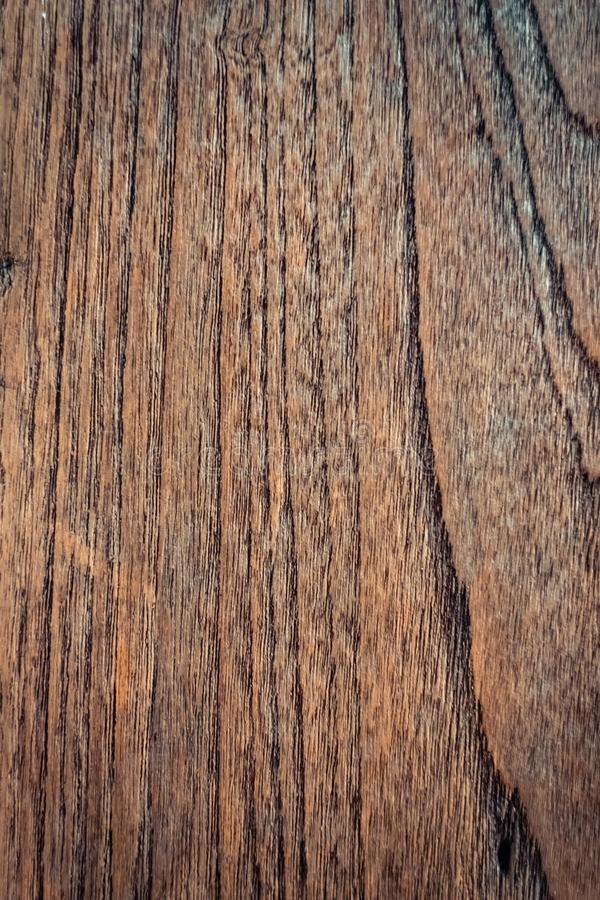 Dark brown wood texture with natural striped pattern background royalty free stock image