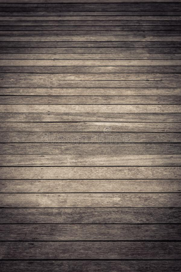 Dark brown wood texture with natural striped pattern background stock image
