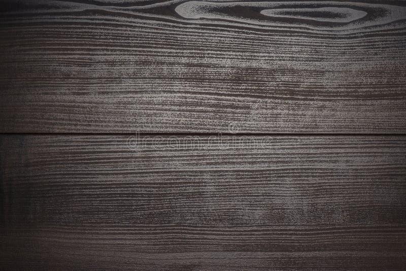 Dark brown wooden background royalty free stock photo