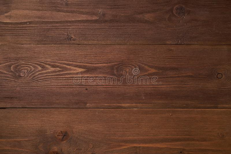 Dark brown wooden background with pine wood, structure of wood with knots stock image