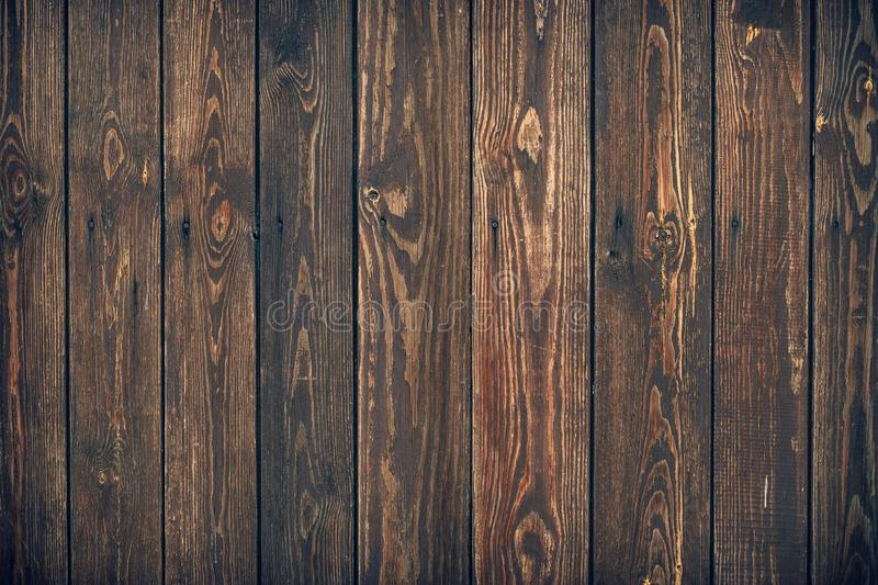 Dark brown wooden planks, texture. Grunge wood background. Rustic backdrop, pattern of natural carpentry floor. Timber wall with a stock photos