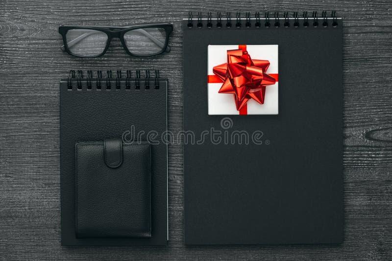 Dark business desktop with gift stock images