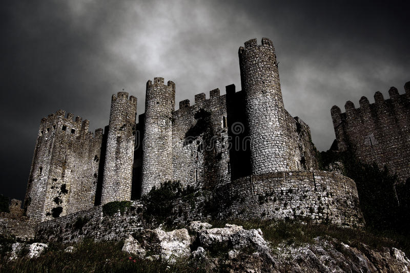 Dark Castle. Disturbing landscape with medieval castle at night with stormy sky