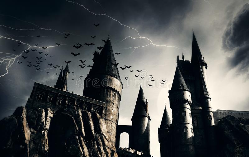 Dark castle with flying bats royalty free stock image