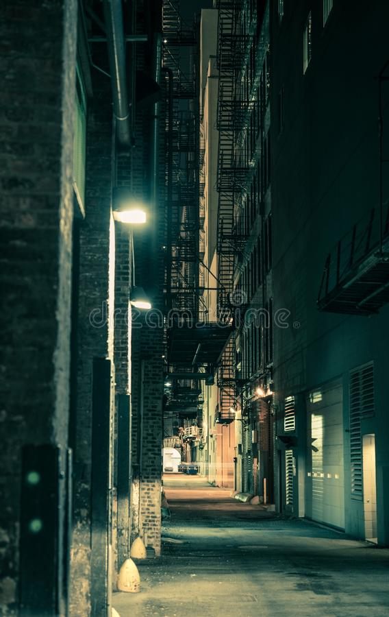 Dark Chicago Alley. Dark and Spooky Chicago Alley in Greenish Color Grading. Vertical Chicago Alley Photo stock photos