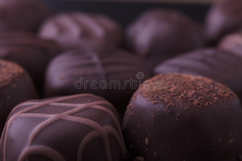 Dark Chocolate Pralines. Closeup of dark filled chocolate pralines from a selection box royalty free stock photo