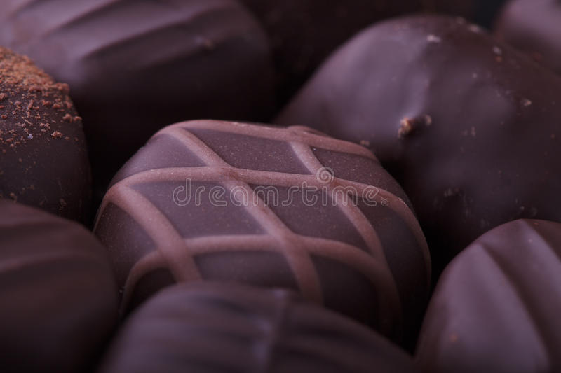 Dark Chocolate Pralines. Closeup of dark filled chocolate pralines from a selection box stock images
