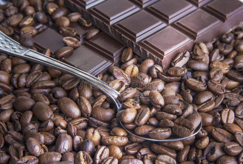 Dark chocolate bars with coffee beans closeup. Dark chocolate bars with coffee beans closeup royalty free stock image