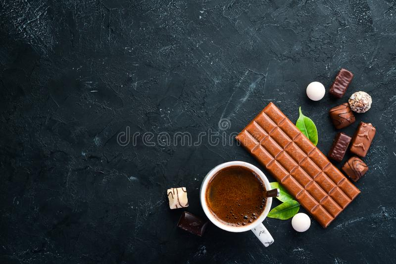 Dark chocolate on a black background. Top view. Free copy space royalty free stock photos