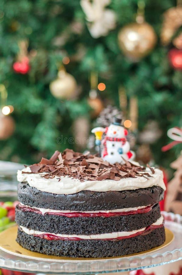 Dark chocolate cake with cream and strawberry jam royalty free stock image