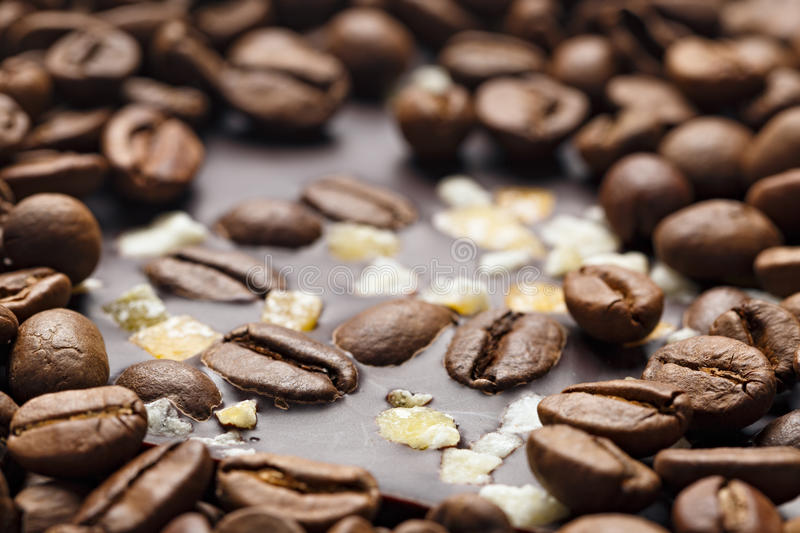 Dark chocolate with coffee grains and fruits. Prepared for the World Chocolate Day. Photographed macro stock photos