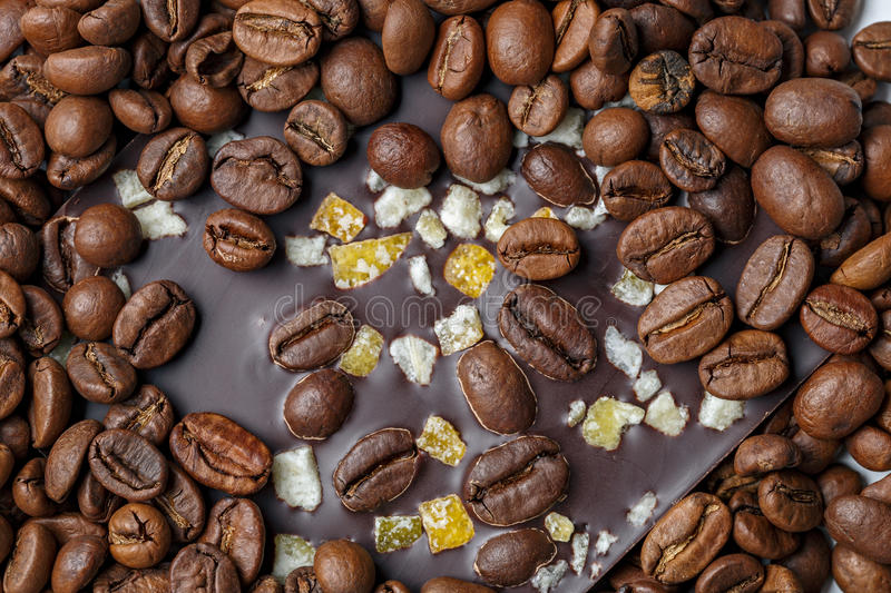 Dark chocolate with coffee grains and fruits. Prepared for the World Chocolate Day. Photographed macro royalty free stock images