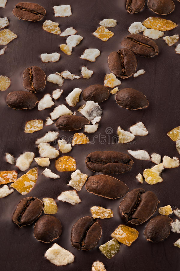 Dark chocolate with coffee grains and fruits. Prepared for the World Chocolate Day. Photographed macro royalty free stock photos