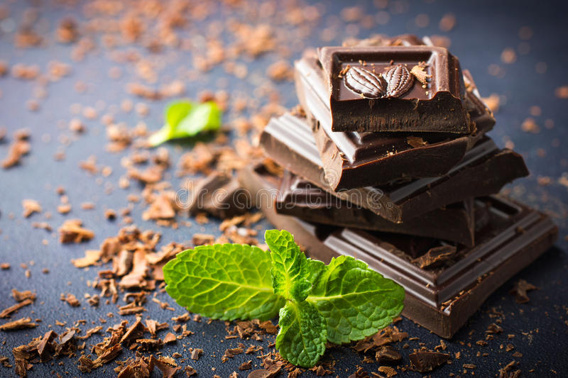Dark chocolate with mint leaf stock images
