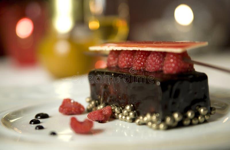 Dark chocolate tart with raspberry wafer royalty free stock image