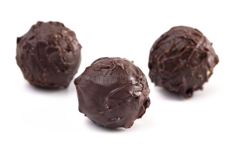 Dark Chocolate Truffles Filled with Caramel on a White Backgroun. Dark Chocolate Truffles Filled with Caramel Isolated on a White Backgroun stock photography