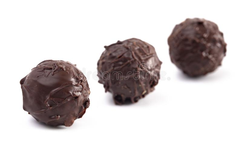 Dark Chocolate Truffles Filled with Caramel on a White Backgroun. Dark Chocolate Truffles Filled with Caramel Isolated on a White Backgroun royalty free stock photos
