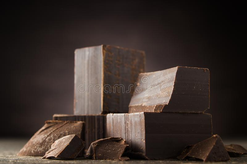 Dark chocolate on a wooden background.  stock images