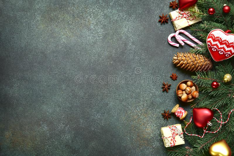 Dark christmas background with fir branchs,toys and gift boxes . stock photography