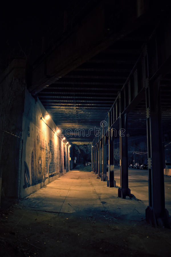 Dark city alley bridge underpass at night. Dark Chicago city alley bridge underpass at night stock photos
