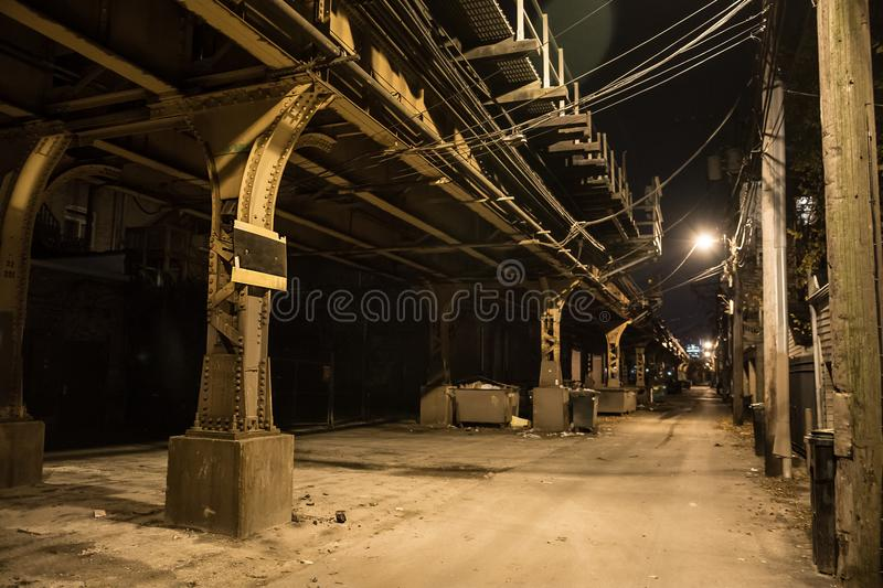 Dark city alley at night. Dark and eerie urban city alley at night stock photography