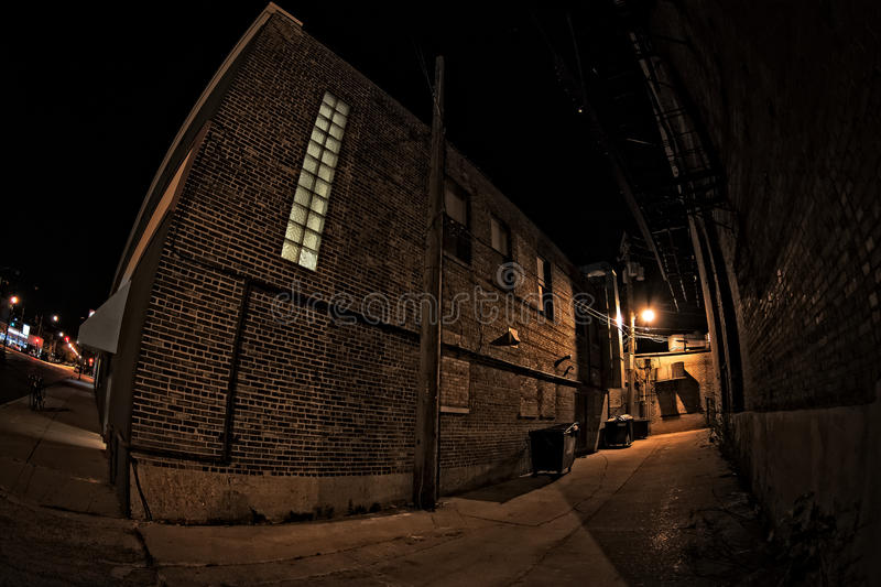 Dark City Alley at Night. Dark urban city alley at night royalty free stock photo