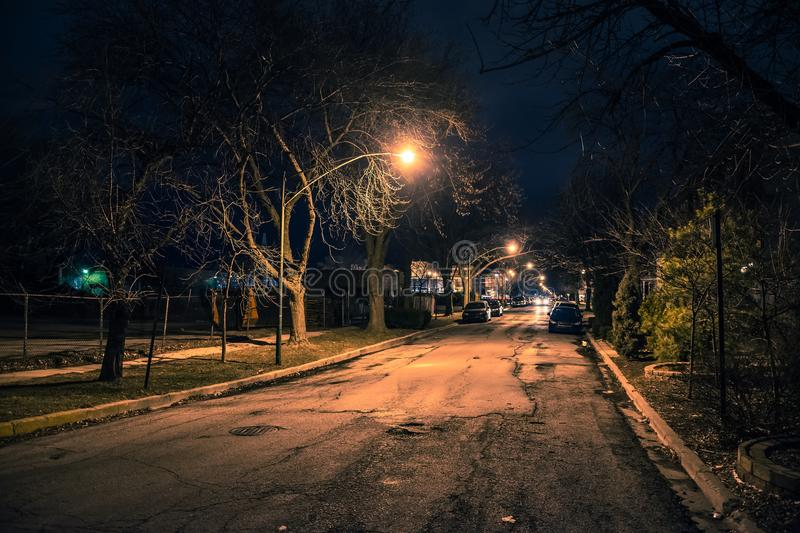 Dark city street at night. Dark and eerie urban city street at night royalty free stock images