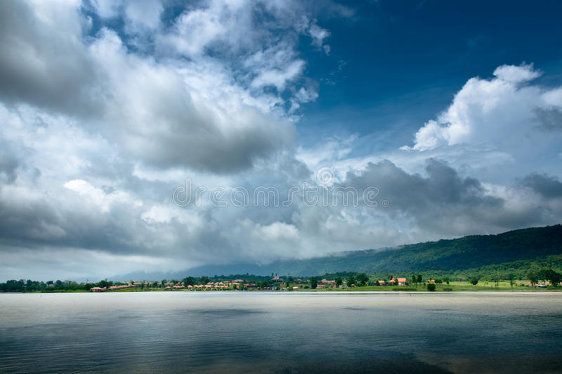 Dark Cloud on blue sky. And green Mountain stock image