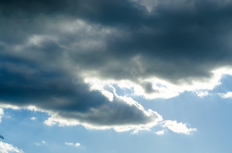 A dark cloud covers the sky. Floats across the sky stock photography